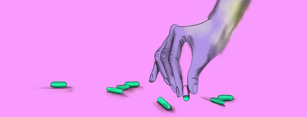 A hand picks up a vitamin pill that is only 25% full.